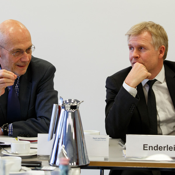Henrik Enderlein, Director of the Jacques Delors Institut sitting at a table, listening